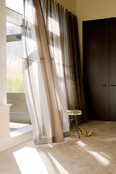 home, residential, bedroom, floor length mohair and silk Bergamo curtains, stool with yellow seat, earth tones, brown closet doors, door to terrace, modern