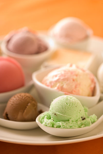 ice cream, green, brown, pink, white dishes, white bowls, orange table top.