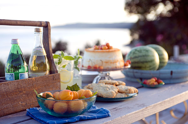 outdoor dining, wood table, watermelons, cake, cookies, sweet treats, apricots, glass bottles