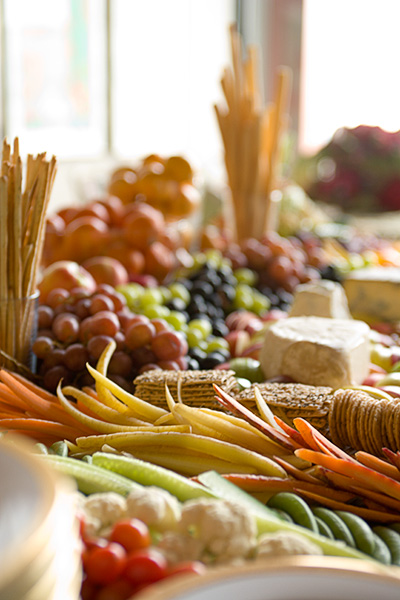 Cheese platter, fruit, vegetables, crackers, bread sticks, grapes