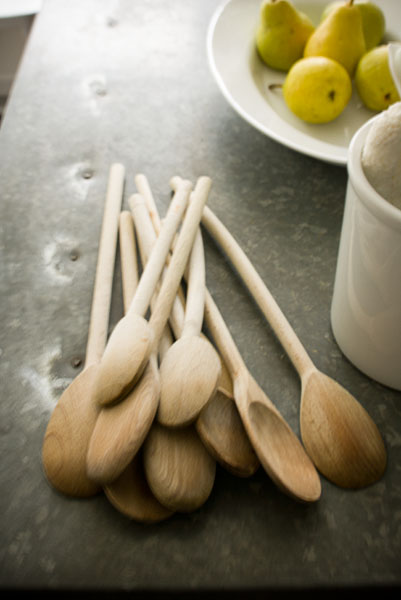 wooden spoons, countertop, pears