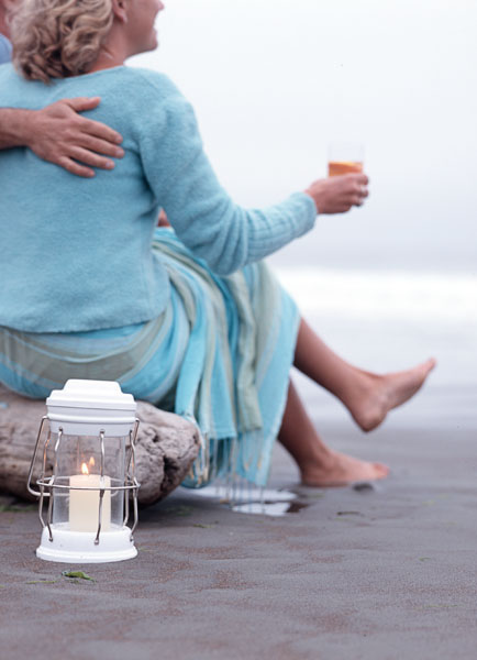 beach, sand, woman, couple,man, lantern, lamp, blue clothing, drink, cocktail