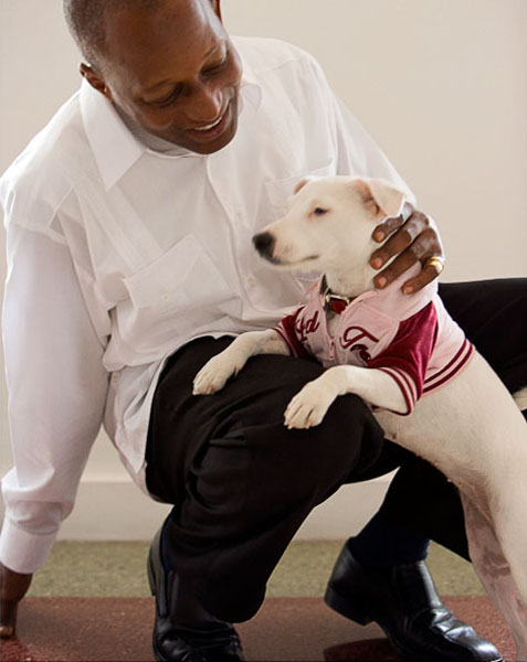 man, dog, white shirt, white dog, dog jacket