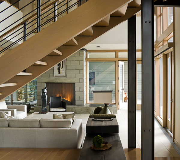 home, residential, living room, wood staircase,stone fireplace, gray couch, steel beams, architectural photographers, interior photographers, seattle