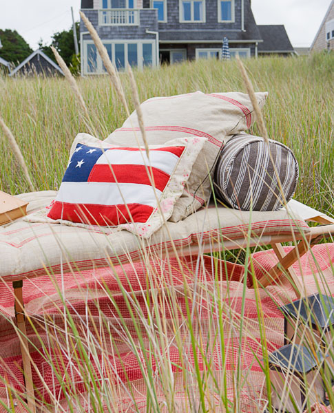 residential, beach house, lawn furniture, american flag, lanterns, red and white fabric, tall grass
