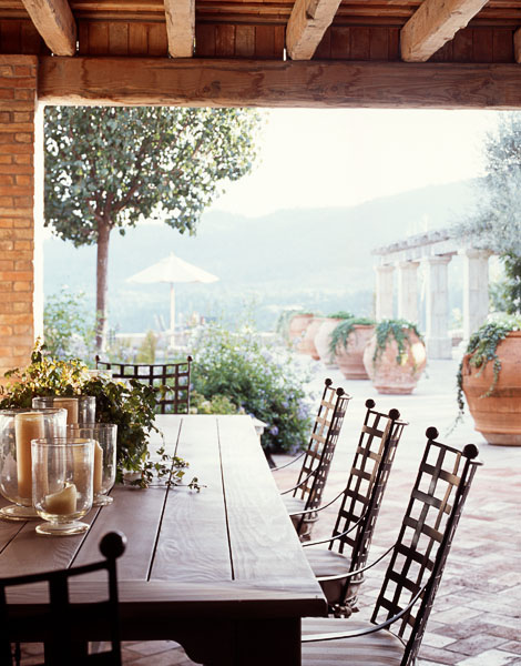 residential, dining, wood table, metal chairs, veranda, wood covering, large pots, candles