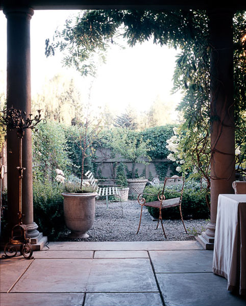 view from veranda to garden, stone columns, plants, gravel